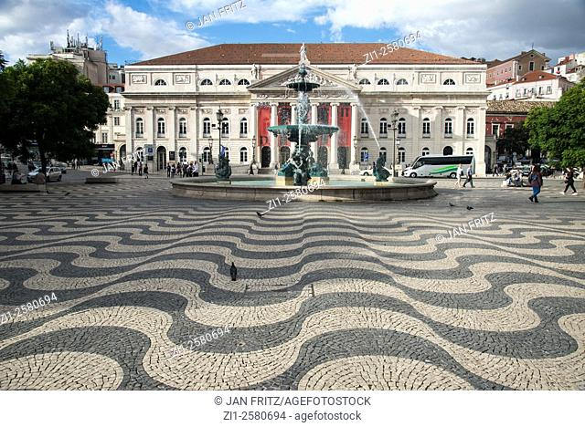 baroque fountain and neoclassical building at square in baixa in centre of lisboa portugal