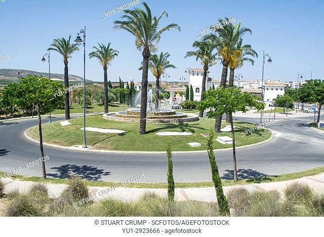 Traffic island planted with palm trees at the entrance to Hacienda Riquelme Golf Resort in Murcia Spain