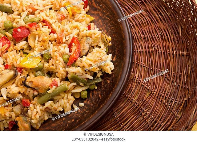 National dish of Spain - Fish paella. A dish which uses the spice saffron