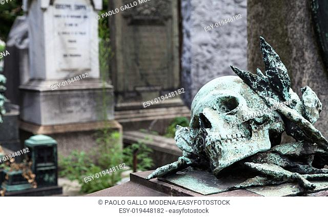 More than 100 years old statue. Cemetery located in North Italy