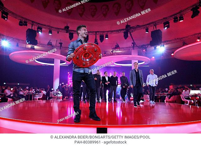 MUNICH, GERMANY - MAY 14: Joshua Kimmich walks out with The Meisterschale, the trophy of the German football championship during the FC Bayern Muenchen...