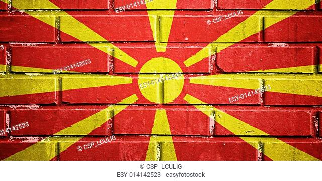 Macedonia flag on brick wall