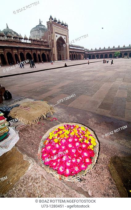 A flower vendor selling his colorful flowers at Fathehpur Sikri, India