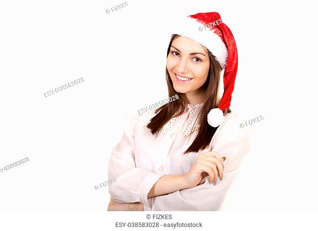 Office employee, beautiful young business woman in white shirt and red Santa Claus Christmas hat friendly smiling. Holidays, discounts, sales concept, isolated