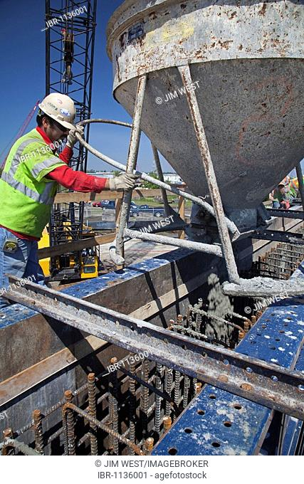 Contractors for the Army Corps of Engineers build a flood wall along the Harvey Canal designed to better protect the New Orleans area from flooding during...