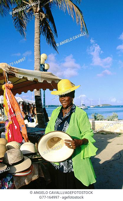 Woman vendor at market. Marigot. Saint Martin. Department of Guadeloupe (France)