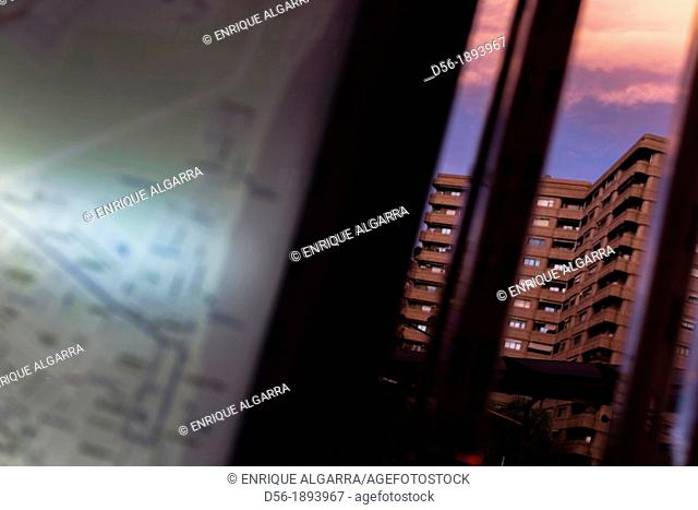 city map and building at dusk, Aragon Avenue, Valencia, Spain