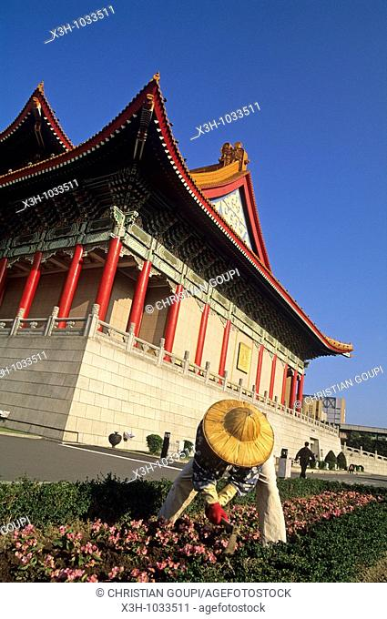 gardener in front of National Concert Hall, Taipei,Taiwan also known as Formosa,Republic of China, East Asia