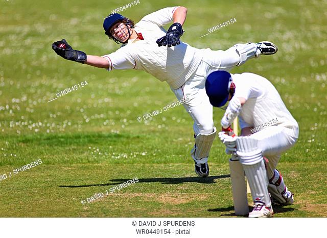 A wicket keeper takes the catch after the batsman edges