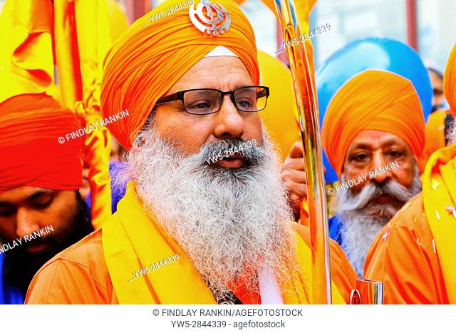 Sikh procesion of religious leaders, Panj Pyare, the beloved ones at the annual harvest festival of Vaishakhi, outside the Gurdwara, Otago Street, Glasgow