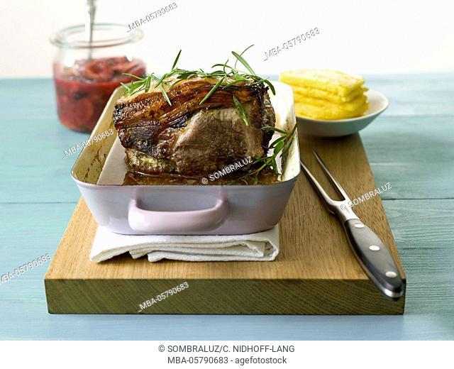 Roast lamb with rosemary, stewed plum and polenta slices