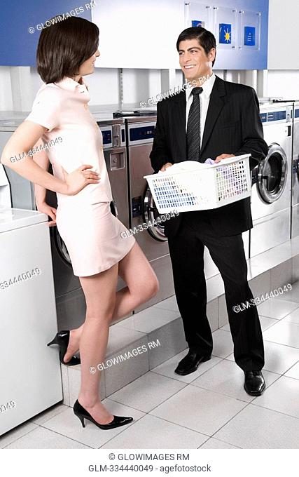 Couple talking to each other in a laundromat