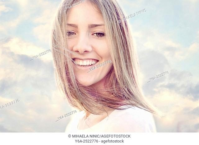 Smiling young adult woman portrait
