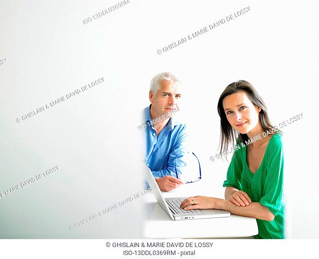 Woman working on computer with colleague