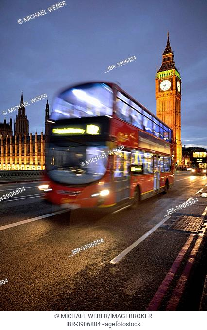 Red double-decker bus in front of Elizabeth Tower or Big Ben and the Palace of Westminster or Houses of Parliament at dusk, UNESCO World Heritage Site, London