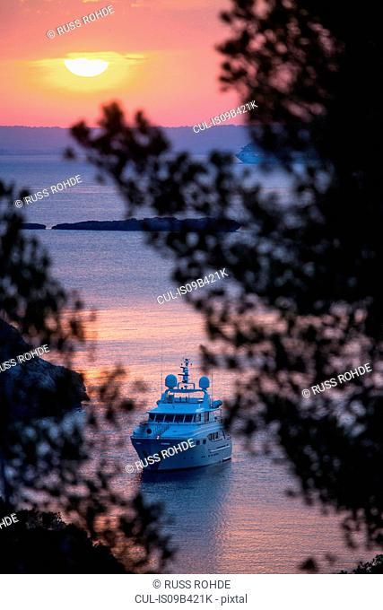 Yacht anchored off coast at sunset, Calvia, Majorca, Spain
