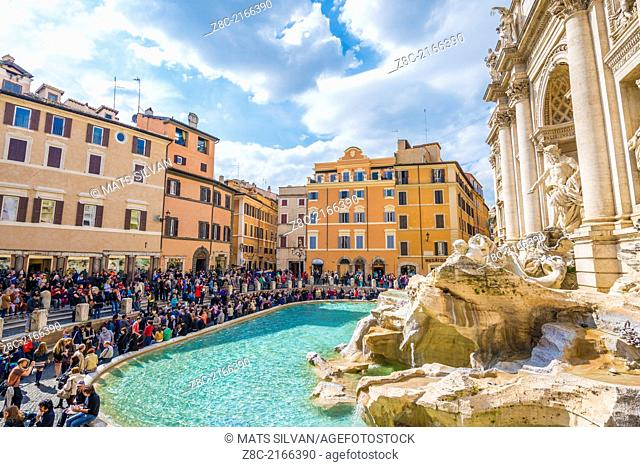 Crowd with people in a sunny day in fountain Trevi in Rome Italy