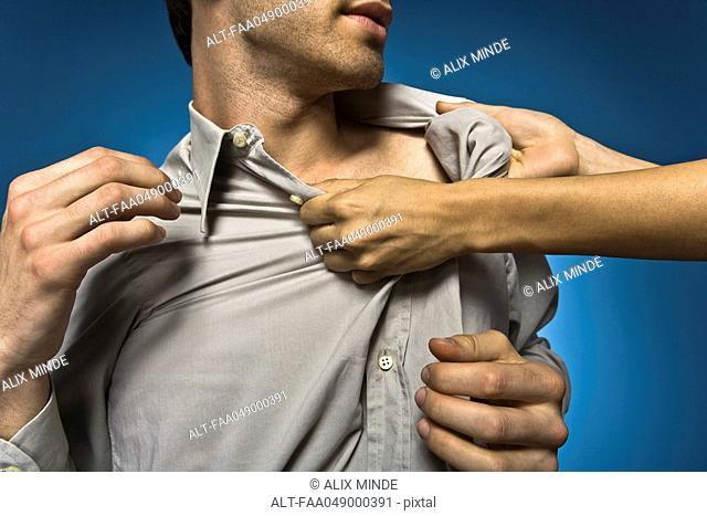 Woman grabbing man by shirt collar