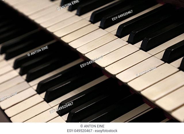 Close up old vintage manual double keyboard (bank of keys) of church organ, high angle view