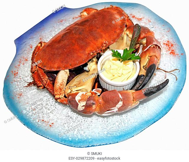 Cooked crabs with sauce on blue plate