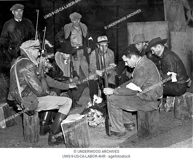Verdi, Nevada: October 10, 1938.A group of posse men keep a campfire vigil in Nevada near the state line on Highway 50. They took up posts there when a group of...
