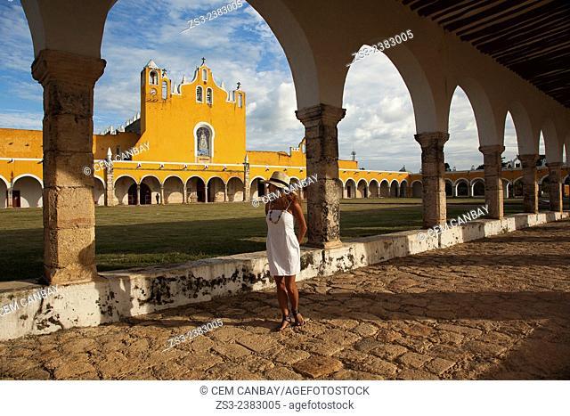 Woman posing at Izamal convent, Monastery-Convent Of San Antonio De Padua, Izamal, Yucatan, Yucatan Province, Mexico, Central America