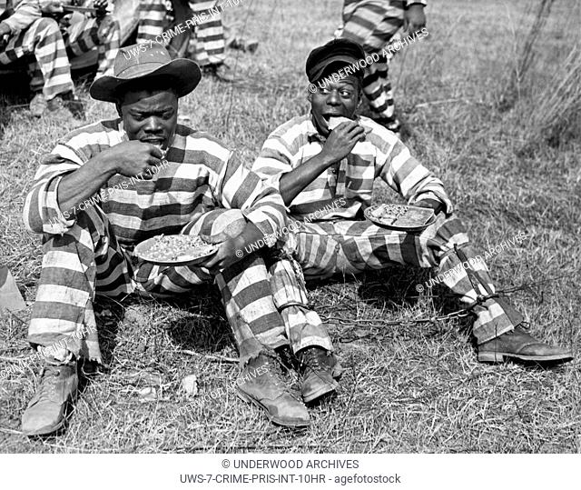 Macon, Georgia: March 8, 1937 Two members of a Bibb County chain gang eating their midday meal of cornbread, peas and fatback
