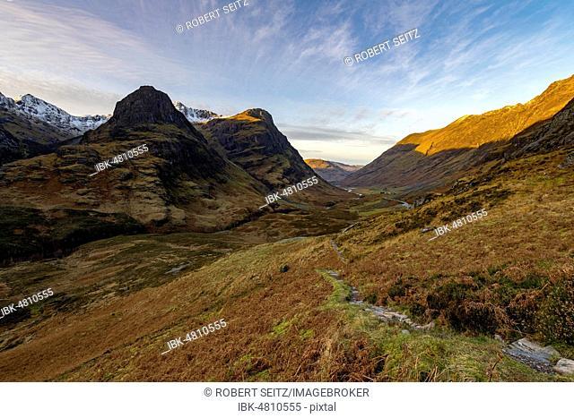 Hiking trail in mountain scenery with peaks of Stob Coire nan Lochan, Glen Coe, west Highlands, Scotland, United Kingdom