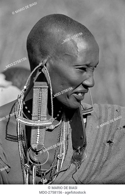 Young Maasai woman wearing the typical earrings nearby Nairobi. Africa, April 1965