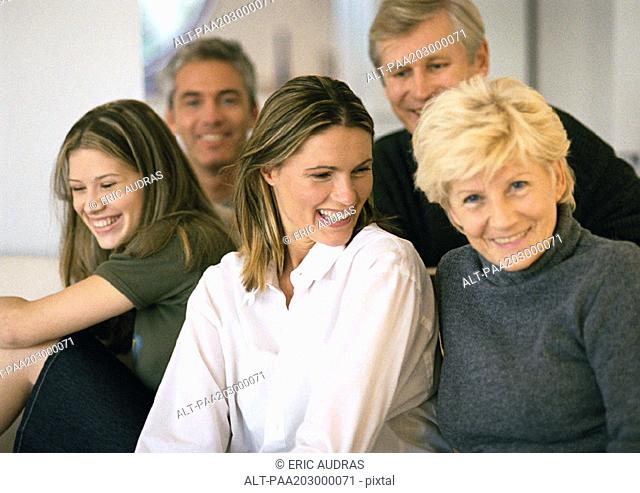 Five people grouped together, smiling, close-up, portrait