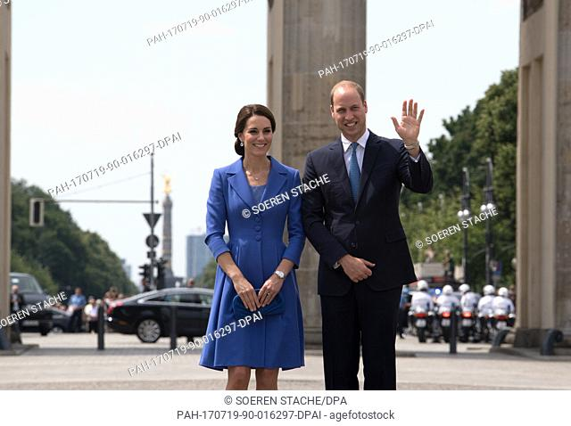 Britain's Prince William (R) and his wife Catherine, Duchess of Cambridge, seen during a visit to the Brandenburg Gate in Berlin, Germany, 19 July 2017