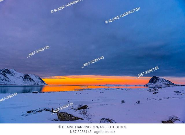 On a cloudy day, a window of sun comes at sunset, Vestvagoya Island, Lofoten Islands, Arctic, Northern Norway