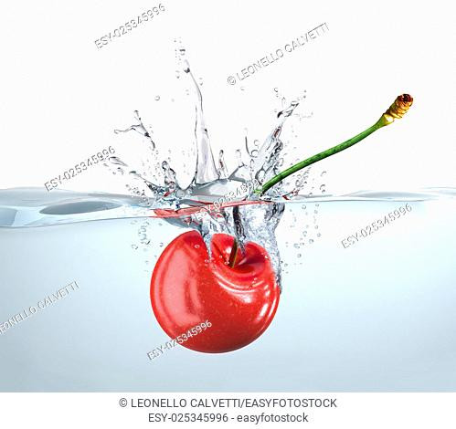 Red cherry falling into clear water and splashing. Close up view