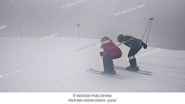 Girls skiing on snow covered mountain, Whistler, British Columbia, Canada