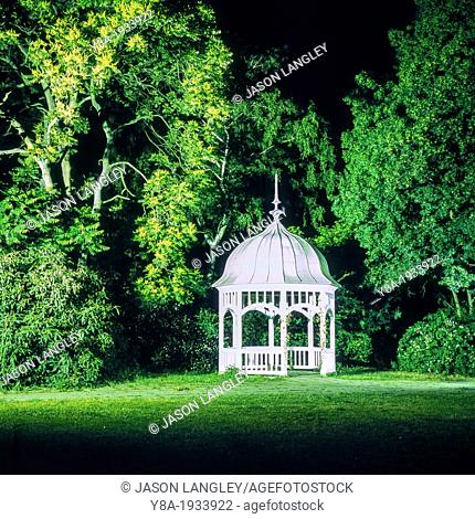 A small white pavilion illuminated at night in Johannapark, Leipzig, Saxony, Germany
