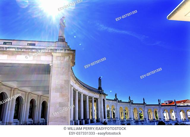 Sun Rays 100th Cellebration Mary's Appearance Basilica of Lady of Rosary Bell Tower Fatima Portugal. Church created on site where three Portuguese Shepherd...