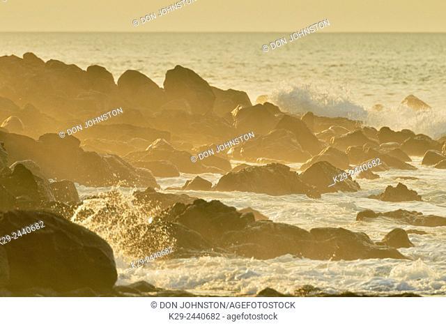 Pacific surf crashing on the rocks near sunset, Galapagos Islands National Park, San Cristobal, Lobos Island, Ecuador