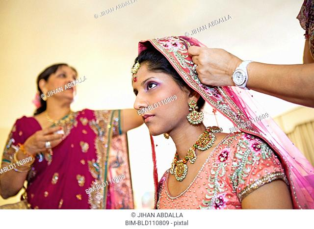 Indian bride wearing colorful fabrics and jewelry
