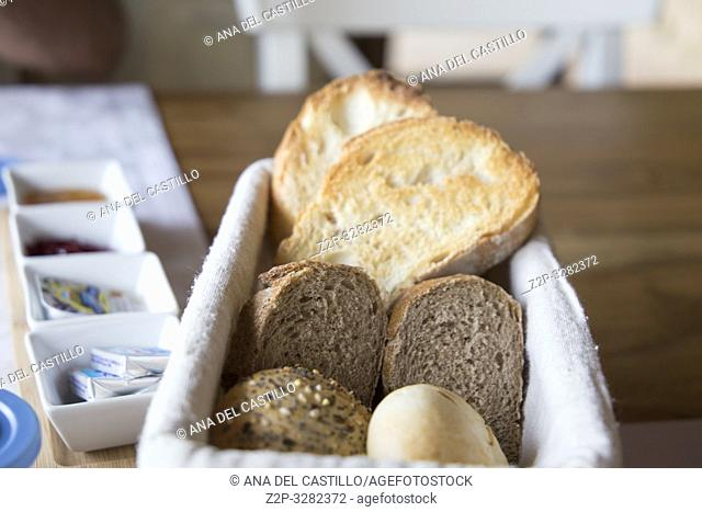 Breads and salts on table at gourmet restaurant Spain