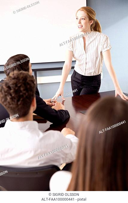 Businesswoman facilitating group discussion at business meeting