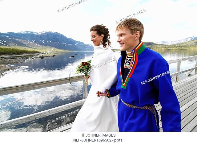 Newlywed couple on jetty