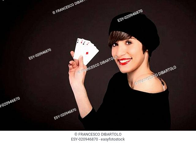 Smiling girl with french style outfit with four aces