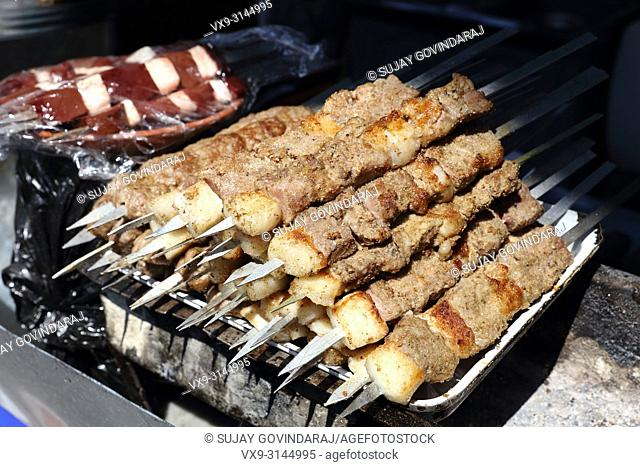 Close shot of shashlik, a uzbek regional food prepared from mutton liver in a traditional style
