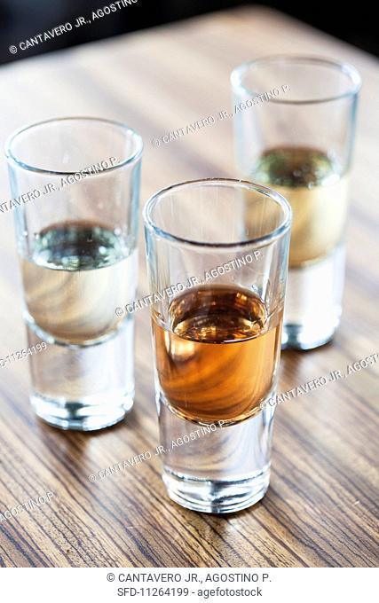Three shot glasses of tequila