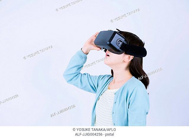 Japanese woman using virtual reality device
