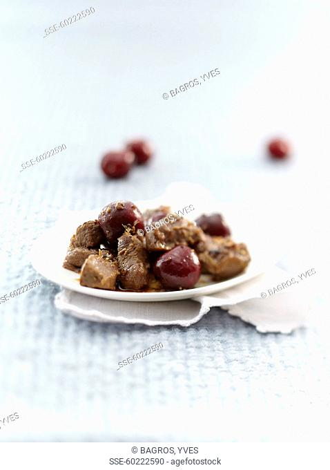 Pan-fried lamb with cherries