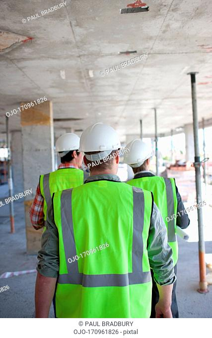 Construction workers walking on construction site