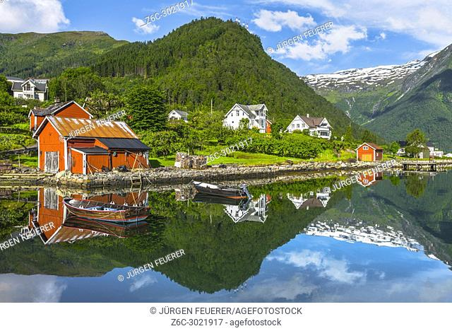 boats and red fishermen hut, Norway, seahore and bay of Balestrand with mirroring of snow mountains, Esefjorden, Sognefjorden