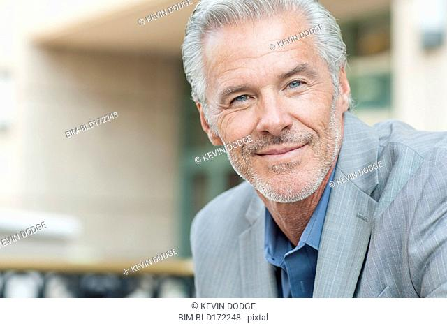 Close up of Caucasian businessman smiling