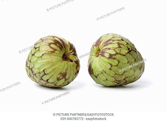 Pair of whole Cherimoya fruit isolated on white background